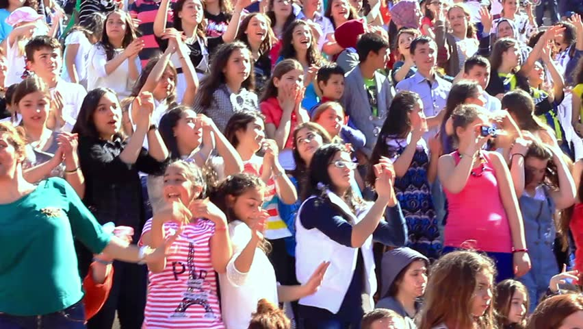 ISTANBUL - APRIL 22, 2012: People having fun at the National Sovereignty and Children Day Festival. Children's Festival was first celebrated in Turkey on 1920. Cheerful audience