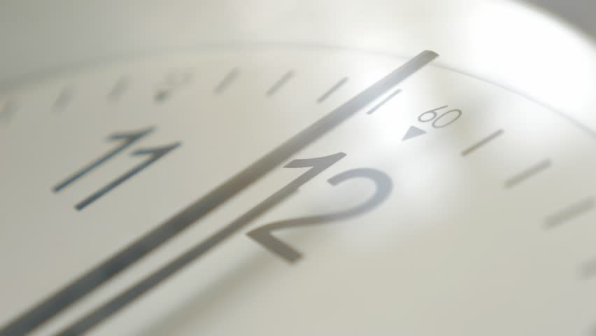 Clock needles slow movement and showing midday hours 4K 2160p UHD footage - Shallow DOF modern clock needles showing noon hour time 4K 3840X2160 UHD video