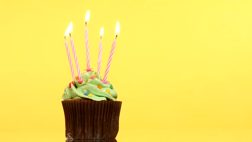 Tasty Birthday Cupcake With One Candle On Yellow