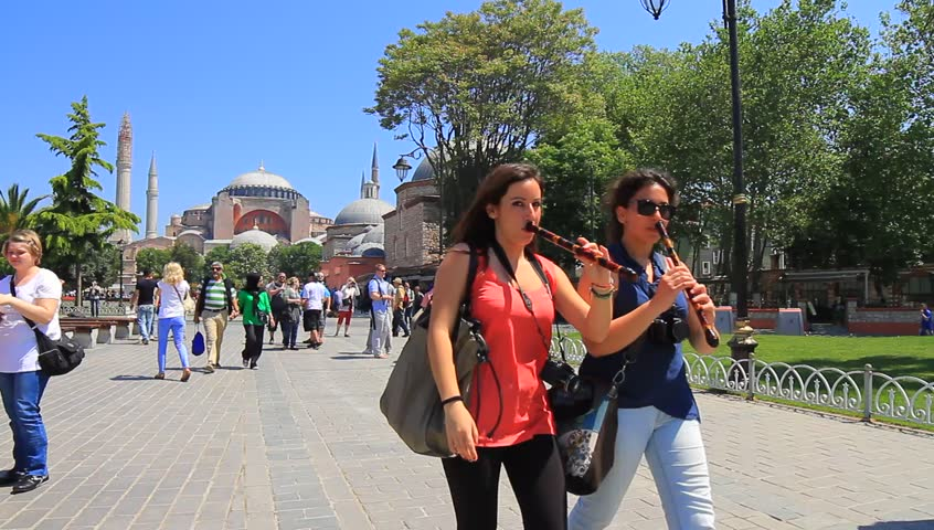 ISTANBUL - MAY 16, 2013: Tourists walks around Hagia Sophia. It is the forth largest building in the world that was made as a church. Tourists in front of Hagia Sophia