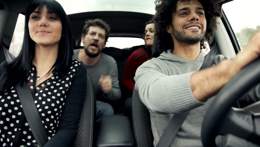Friends in car singing and dancing like crazy | Shutterstock HD Video #8948719