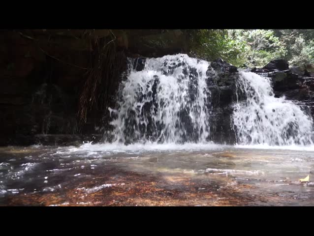Pure fresh water waterfall in forest.  - HD stock footage clip