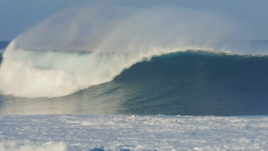 an unridden wave breaks on the north shore of oahu