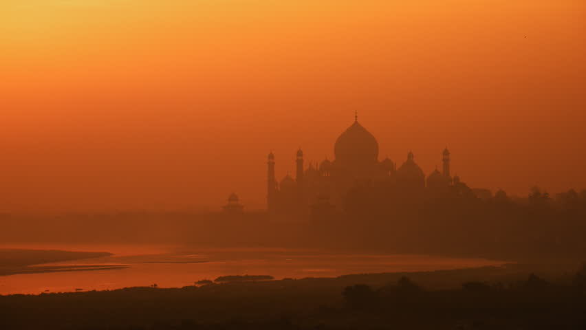 Sunrise at Taj Mahal, Agra. Birds flying in the foreground. - HD stock video clip