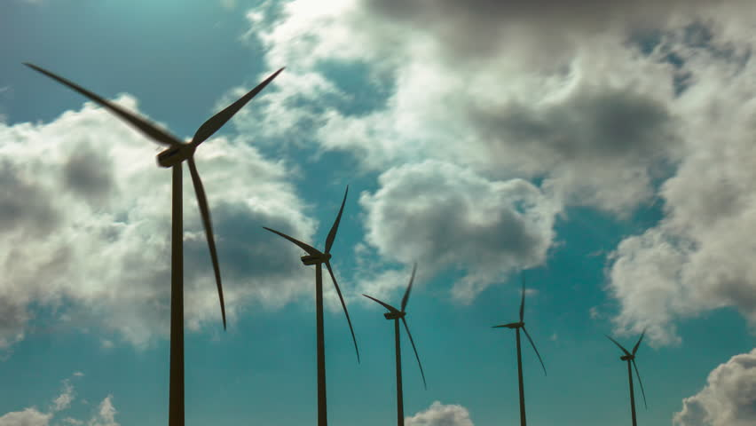 4K wind mill turbines site on mountain timelapse with cloudy sky.A series of 4K timelapses of a wind turbines site, on a mountain top generating clean, green,renewable, energy. - 4K stock footage clip