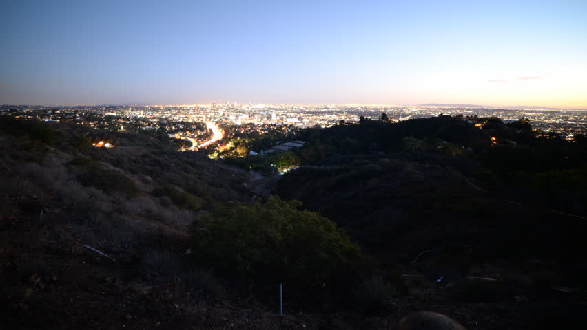 4K Time lapse footage with tilt up motion of Los Angeles cityscape at twilight wide shot in Los Angeles, California