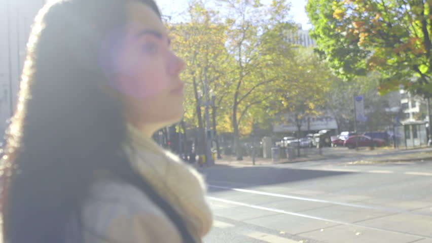 Camera Moves Around Mixed Race Young Woman Waiting At A Crosswalk In The City