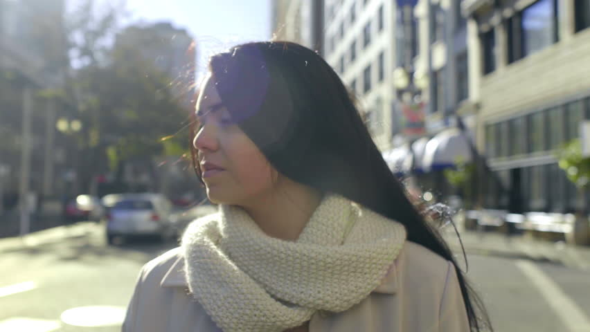 Closeup Of Mixed Race Young Woman Smiling And Happy In The City On A Beautiful, Windy Day