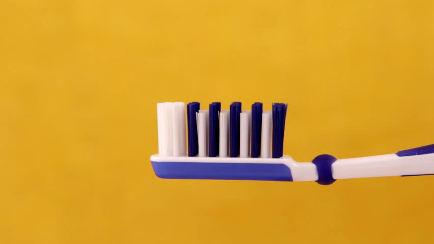 Toothpaste on the toothbrush closeup