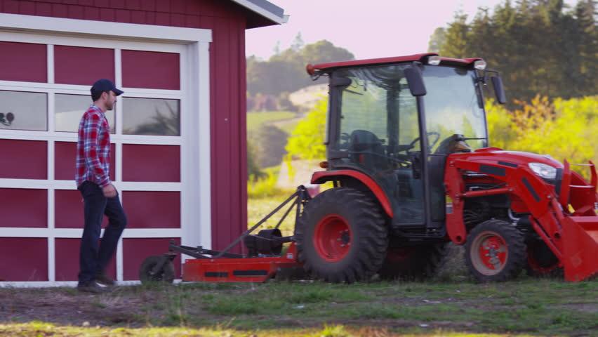 Farmer gets into tractor