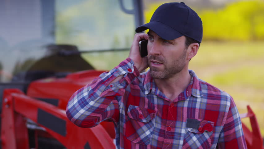 Farmer talking on cell phone