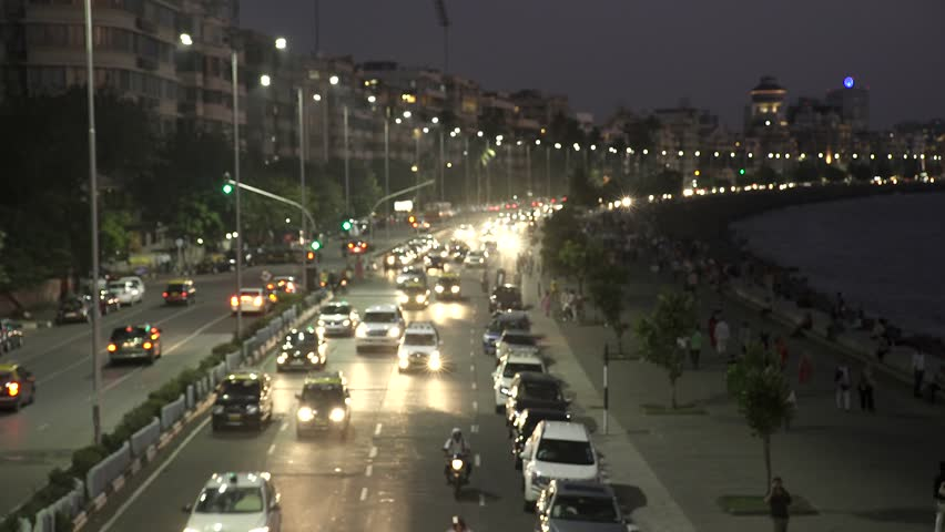 Vehicle Traffic in evening at Marine Drive the Queen's necklace,with new electricity saving LED daylight like street lights, Mumbai, Maharashtra, India.