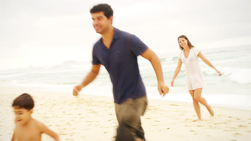 Family plays together on a beach | Shutterstock HD Video #9049483