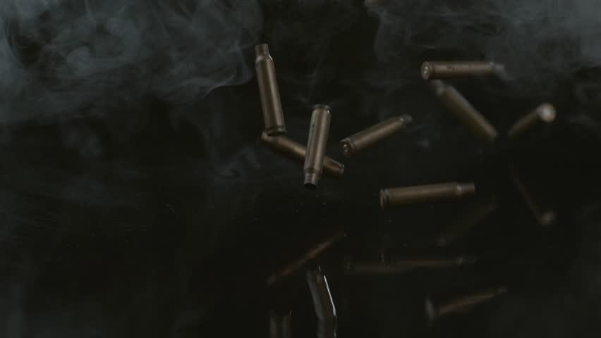Bullet shells and smoke falling in slow motion; shot on Phantom Flex 4K at 1000 fps