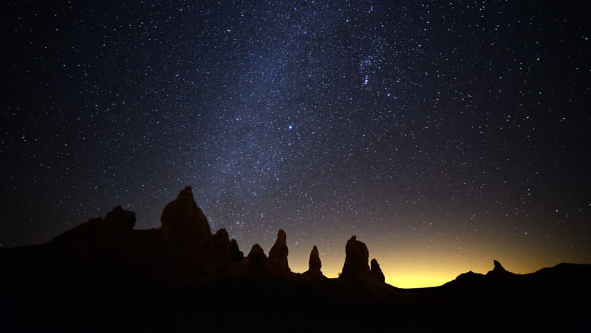 4K Astrophotography time lapse footage with tilt up motion of winter Milky Way galaxy over tufa formations at Trona Pinnacles, California
