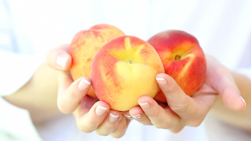 Fresh peaches in a woman's hands. Close up. - HD stock video clip