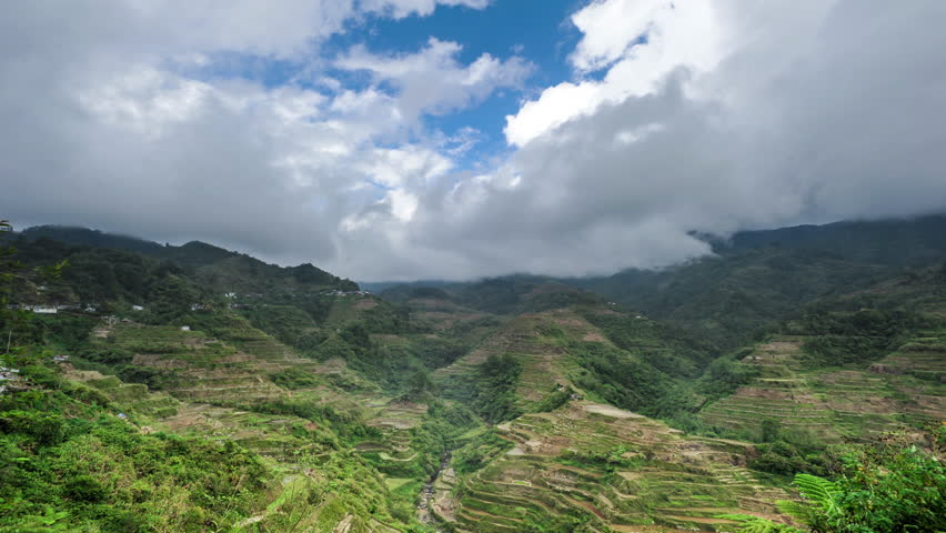 Philippines rice terraces in Ifugao world heritage site. Timelapse of green mountain farm and white clouds