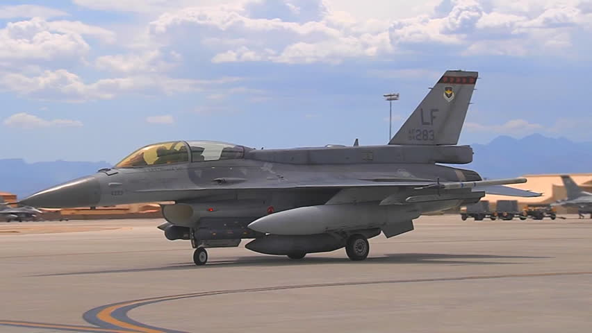 CIRCA 2010s - F-15 and F-16 fighter jets line up and taxi for takeoff.