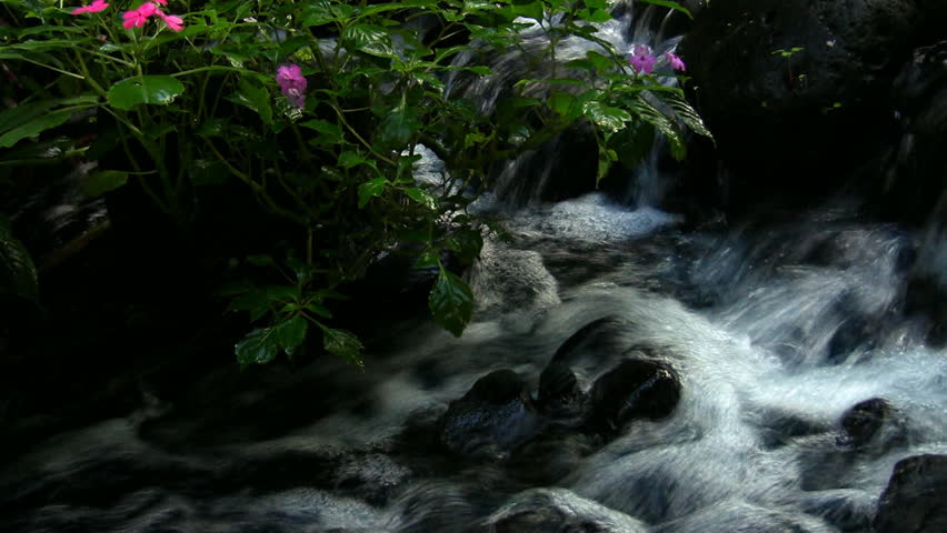 HD water rushing over rocks- good audio - HD stock footage clip