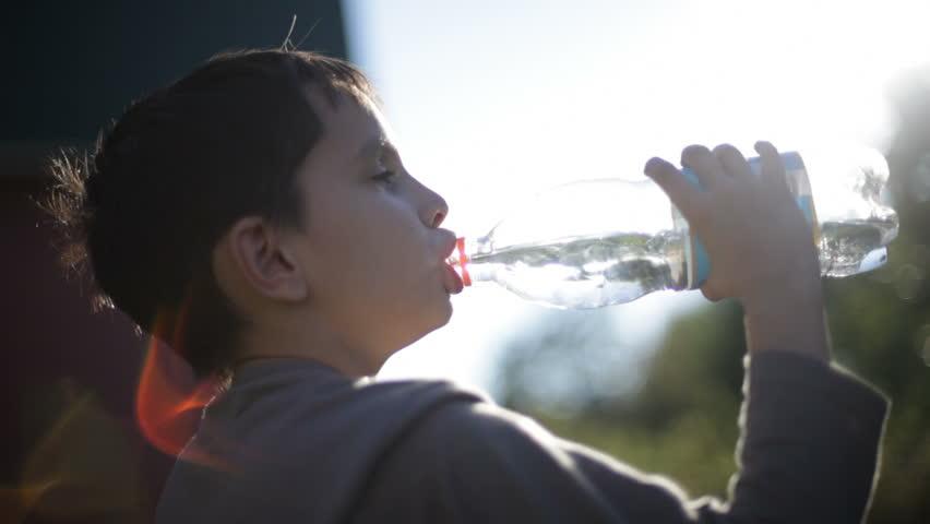 boy drinks water - HD stock footage clip