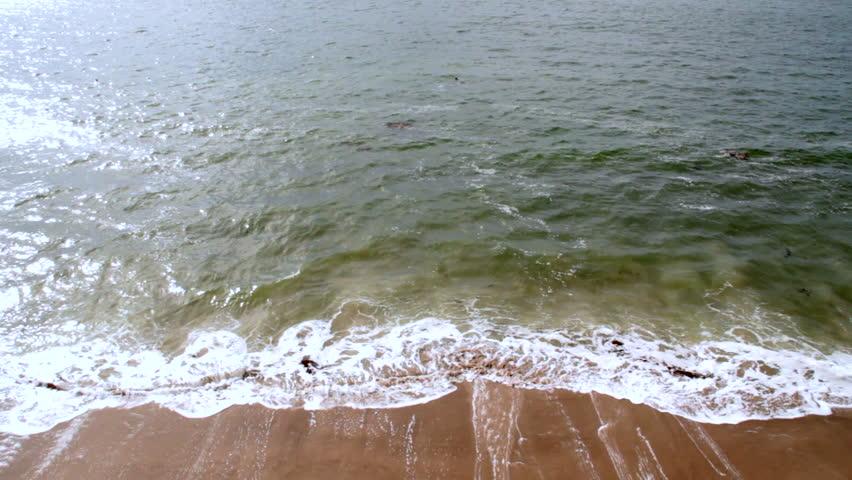 Waves crash against a California beach - HD stock video clip