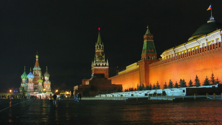 Tourists and townspeople walking at night on Red Square. Time lapse. - HD stock video clip