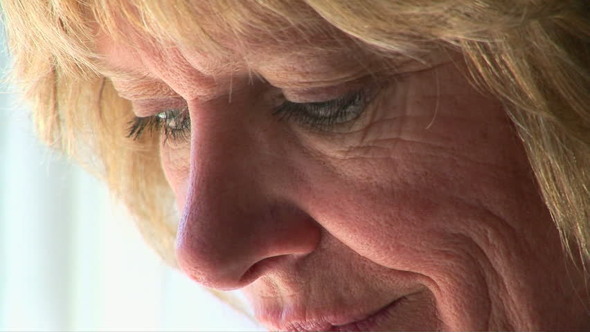 Closeup portrait of mature woman feeling stressed - HD stock footage clip