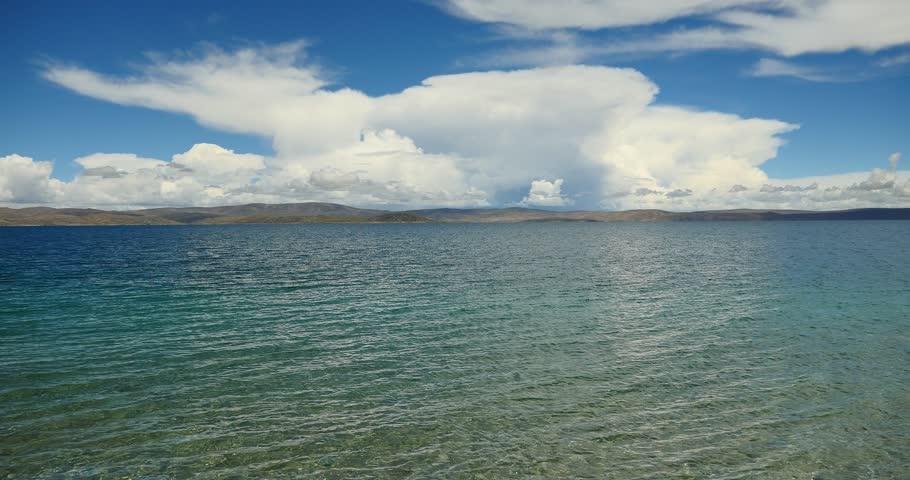 4k huge clouds mass rolling over lake namtso & Tanggula mountain,tibet mansarovar,Tibet's second largest lake,is the third largest saltwater lake in China.gh2_09344_4k