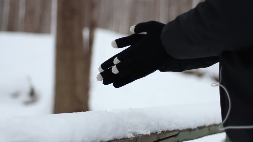 Warming up the hands during a winter stroll - HD stock footage clip