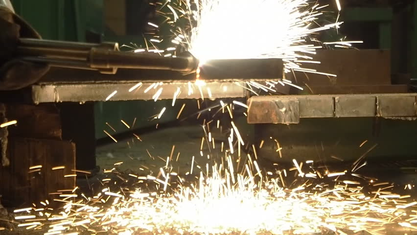 Industrial worker cutting steel by using metal torch, Slow motion.
