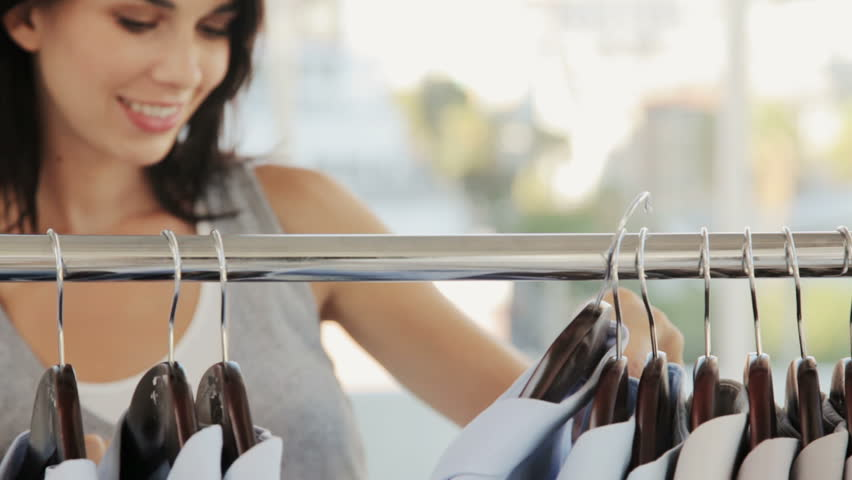 Woman Shopping for Clothing - HD stock footage clip