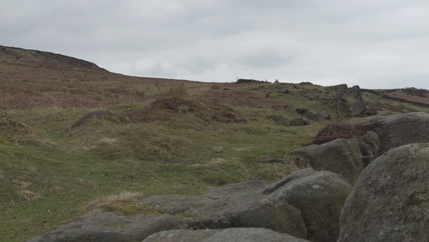Yorkshire Moorland HD stock footage. Medium wide shot of a bleak rural scene with ancient rock formations ideal as an establishing shot. BMD Cinema Camera ProRes 422.