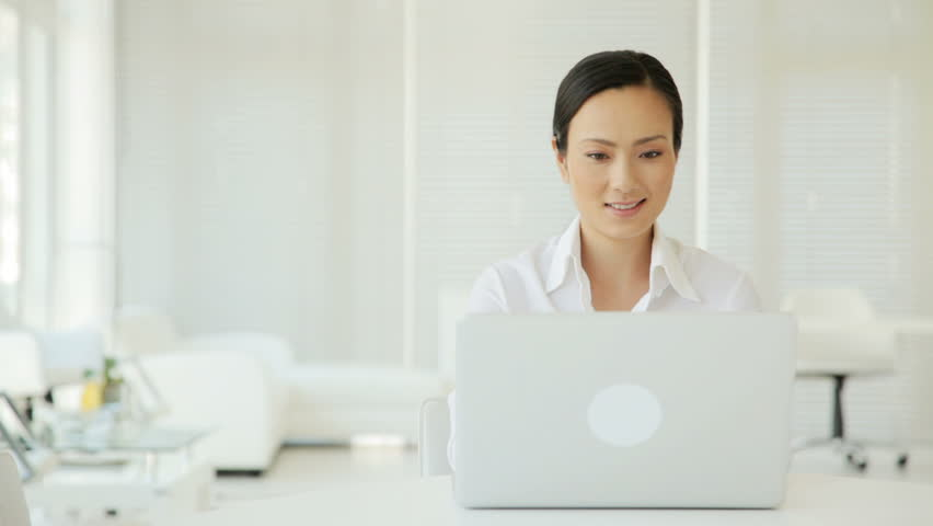 Asian Businesswoman on a Laptop - HD stock video clip