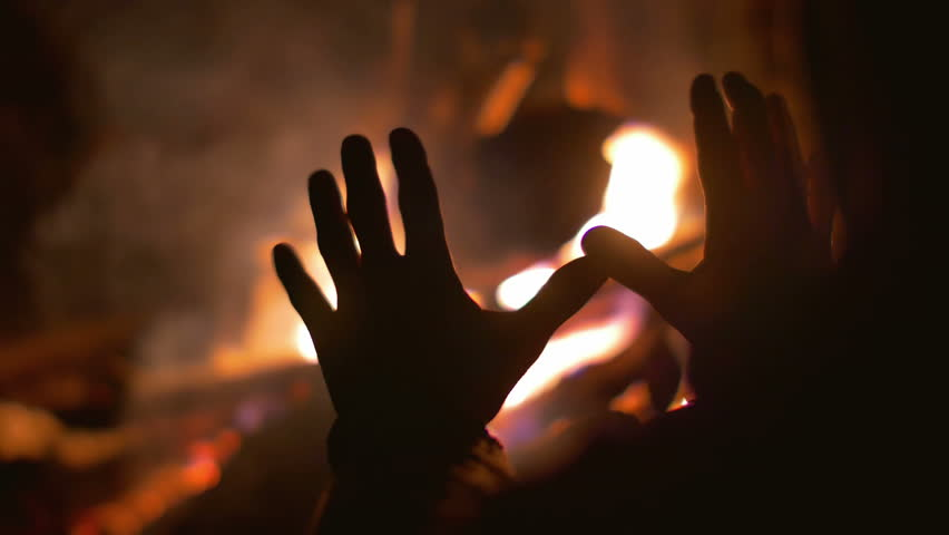 The man warm hands outdoor by the flame background. Heat and powerful flame. Real time capture. Shot with Red Cinema Camera - 4K stock footage clip