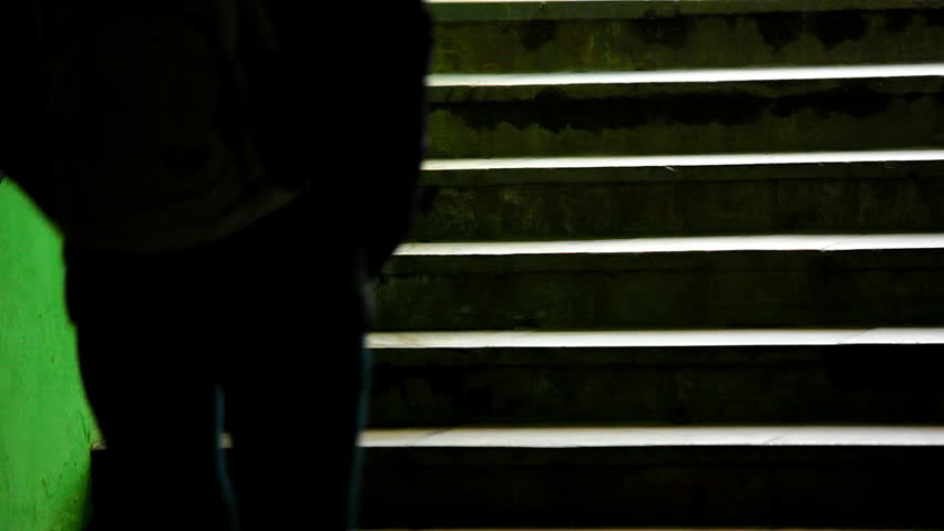Girl on dark green staircase. Girl in yellow shoes walking up the stars. Source: Canon 7D, graded. Clip ID: ax1219c