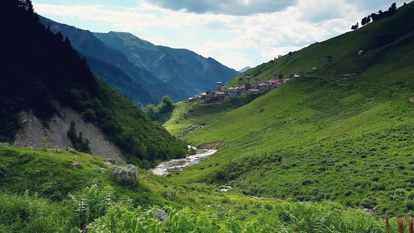 Majestic view of the old village Adishi, Upper Svaneti, Mestia, Georgia, Europe. Caucasus ridge. Dramatic unusual scene. Beauty world. HD video (High Definition)