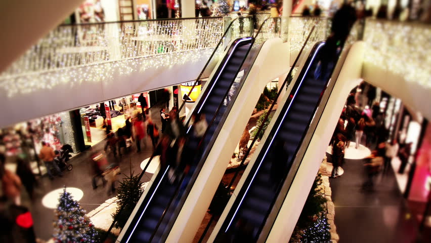 Consumer on 2 escalators in shopping mall  - Time lapse