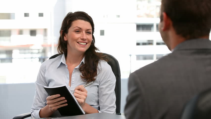 Businesswoman doing an interview in an office - HD stock footage clip