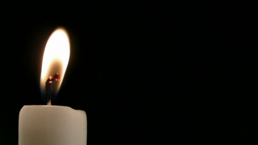 HD 1080p: Blow off a burning candle on black background with