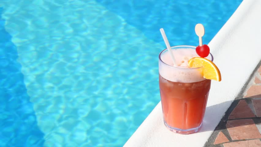 Summer drink with umbrella by the swimming pool stock How to make swimming pool water drinkable