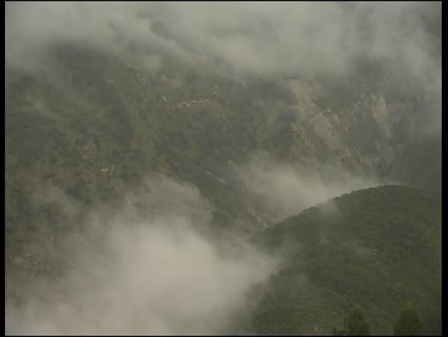 morning mist rising from an Andean valley - SD stock video clip