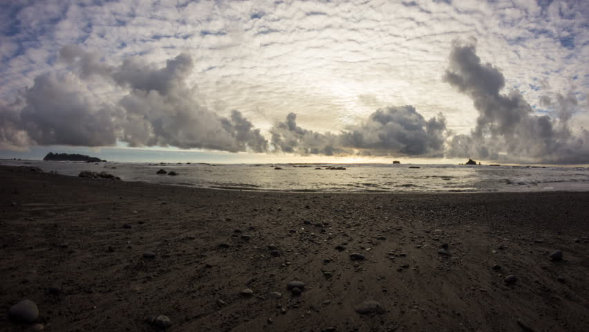 Time lapse dolly move of cloudscape motion at Rialto Beach, Olympic National Park, Washington State, USA during sunset time